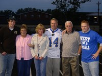 Dennis Hartman and family as his #44 is retired
