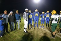 Coin toss commerating the 40th East West Game.