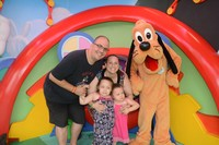 Family with Pluto Disney character