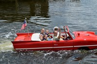 Family on water in boat car