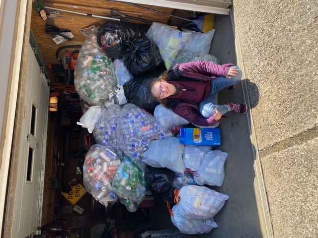 Haley Ellis collects bottles and cans to raise money for National Honor Society scholarships.