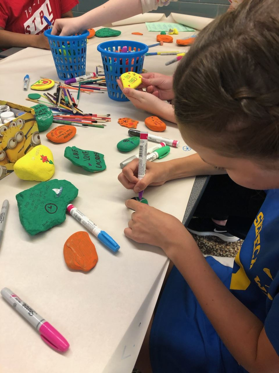 Builders Club paints kindness rocks